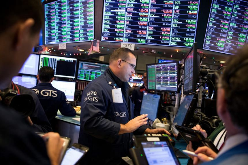 Traders work on the floor of the New York Stock Exchange in New York, US on Dec 3, 2018.
