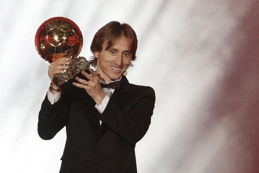 Real Madrid's Luka Modric holds his trophy 'Ballon d'Or' (Golden ball) during the ceremony rewarding the best European footballer of the year in Paris, France, on Dec 3,  2018.