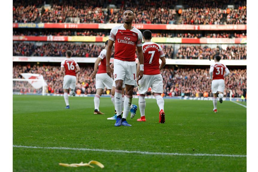 A Tottenham Hotspur fan threw a banana skin onto the pitch at the Emirates Stadium on Dec 2, 2018, as Arsenal forward Pierre-Emerick Aubameyang celebrated scoring a penalty.