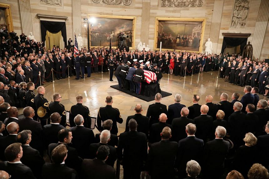The casket of former President George H.W. Bush arrives to lie in state in the US Capitol Rotunda during services on Capitol Hill in Washington, US, on Dec 3, 2018.