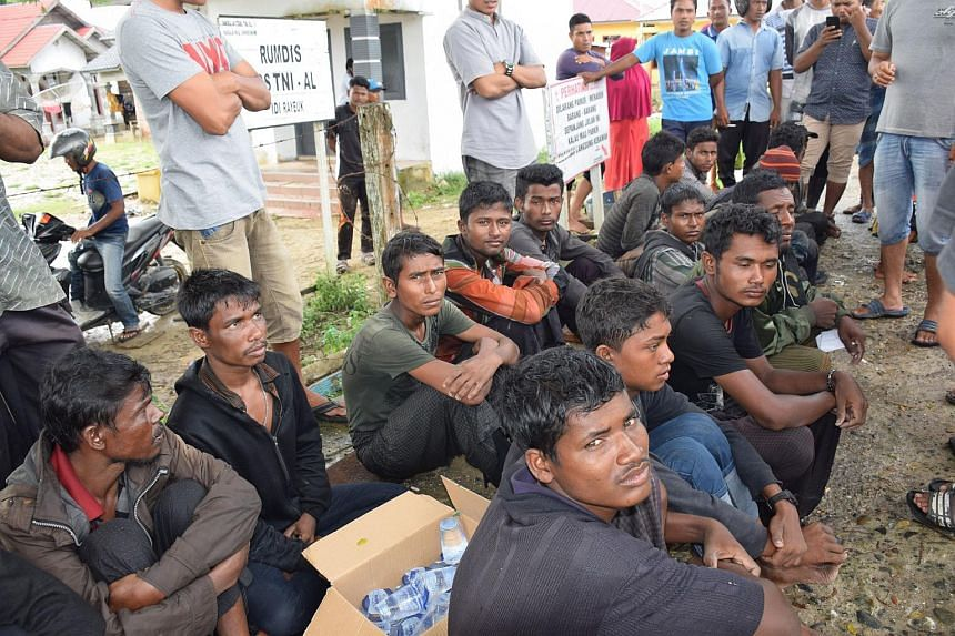 A group of men believed to be Rohingya migrants arrived in Idi Rayeuk, East Aceh, in a rickety wooden boat on Dec 4, 2018.