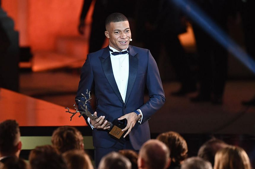 Paris Saint-Germain's French forward Kylian Mbappe receiving the Koppa Trophy during the 2018 FIFA Ballon d'Or award ceremony at the Grand Palais in Paris on Dec 3, 2018.