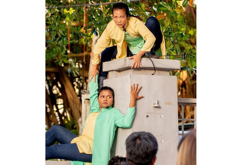 Seong Hui Xuan (top) and Masturah Oli perform skits outdoors in Bitten: Return To Our Roots.