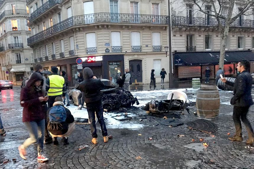 The aftermath of the riots in Boulevard Haussmann, close to the Arc de Triomphe which is near Singaporean shoe designer Mashizan Masjum's atelier. As a business owner, Mr Mashizan said what stood out to him were the shops that were damaged or had t