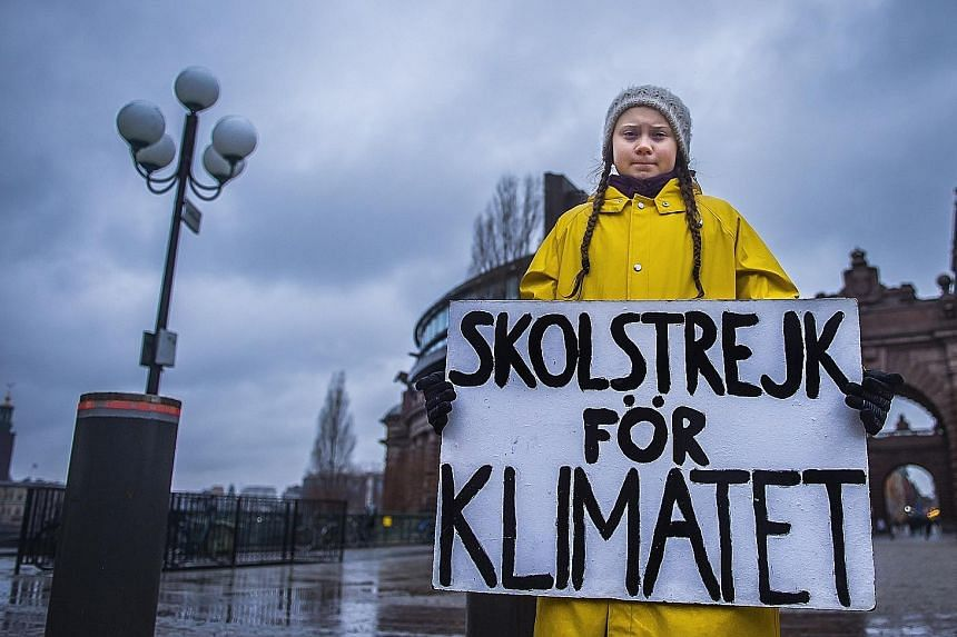 """Student Greta Thunberg holding a placard reading """"School strike for the climate"""", during a protest against climate change outside the Swedish Parliament in Stockholm last week. The 15-year-old Swede has inspired a global movement of children skipping"""