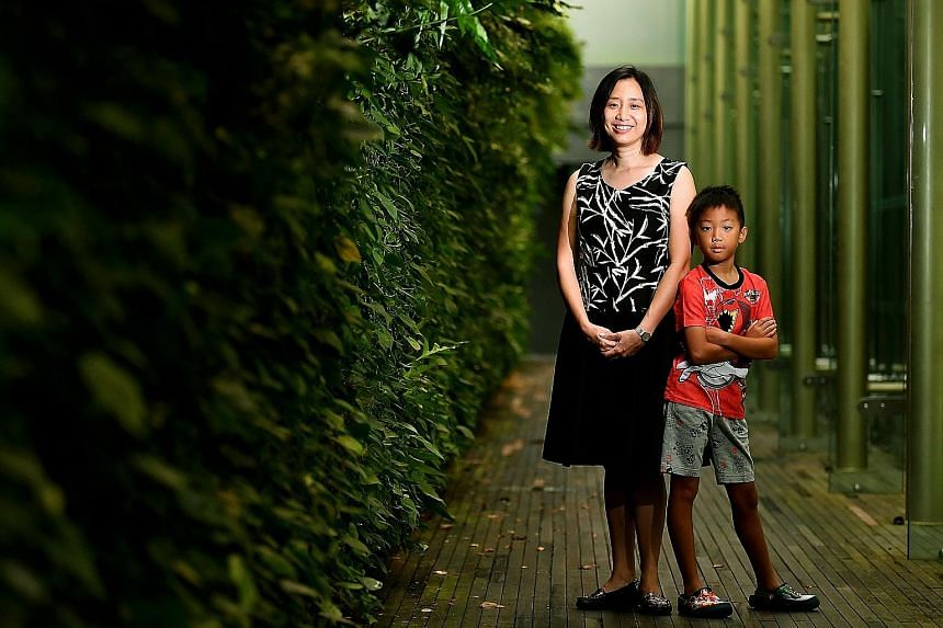 Teacher Er Siew Shin, 39, and her eight-year-old son, Goh Yun Wen, a Primary 2 pupil, at the National Gallery Singapore yesterday. Ms Er has been a Gusto mum since 2009. Gusto was started in October 2008 to study how conditions in pregnancy and early