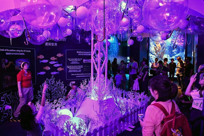 "An experiential lights display, known as the Imaginarium, simulates the depths of the mysterious underwater world, lighting up when visitors clap. Ho ho, ho... It's a merry Christmas as ""Santa Claus"" goes underwater to feed the fishes in the Open Oce"