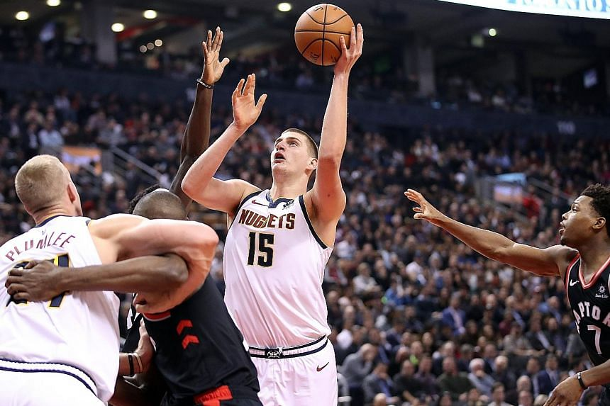 Denver centre Nikola Jokic going up for a shot against Toronto at the Scotiabank Arena. He enjoyed recording his 18th career triple-double with 23 points, 15 assists and 11 rebounds to put the Nuggets joint top of the Western Conference with the Clip