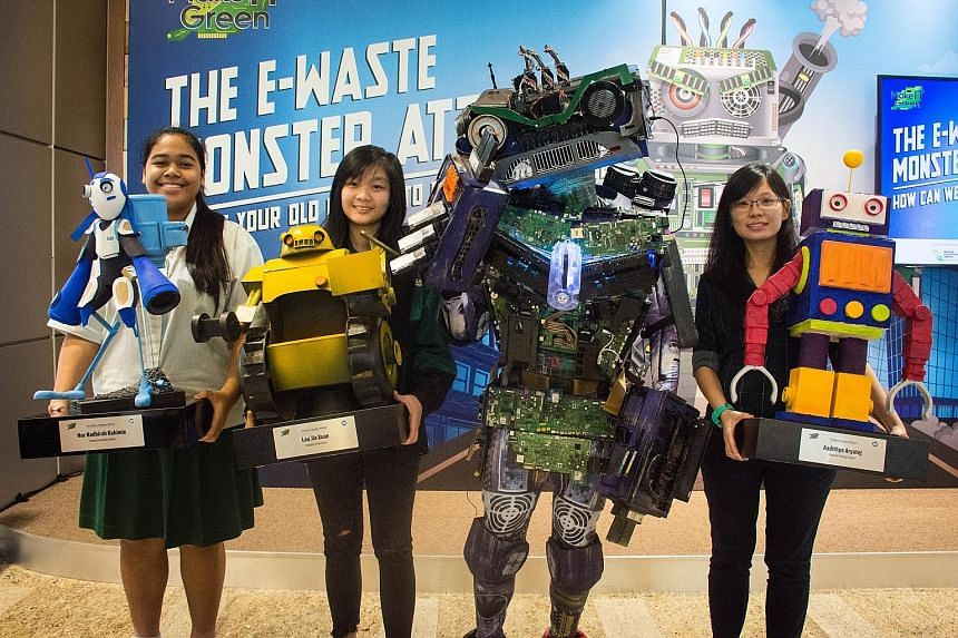 Winners of the competition run as part of the HP Make IT Green campaign, for students to design a Mech Robot using components from used devices: (from far left) Jurong Secondary School's Nor Nadhirah RahimieK, Republic Polytechnic's Lau Jia Xuan and
