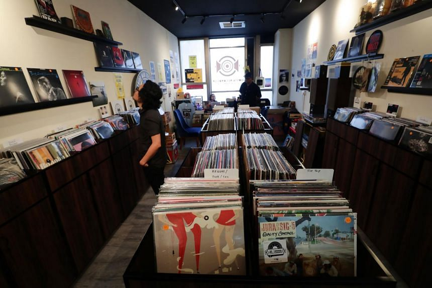 A customer browsing vinyl records at Mosta Records LP, in Peninsula Shopping Centre.
