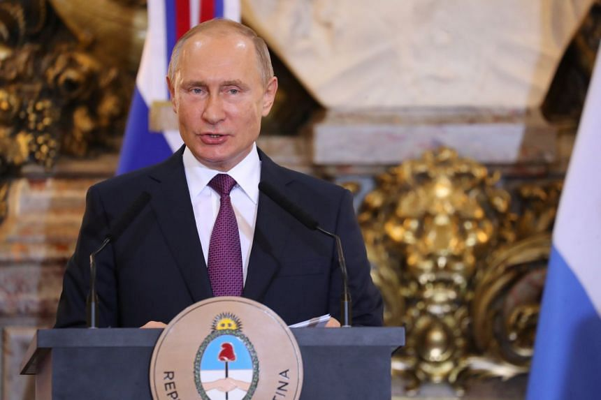 Russia's President Vladimir Putin speaks during a joint news conference at the Casa Rosada Presidential Palace in Buenos Aires, Argentina, on Dec 1, 2018.