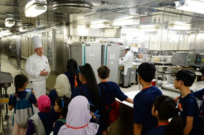 Chef Briones explaining how food is prepared in the ship's galley.  PHOTO: LIANHE ZAOBAO
