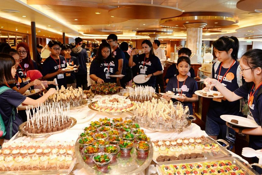 The buffet spread of sweet treats had the children hungry for more.  PHOTO: LIANHE ZAOBAO
