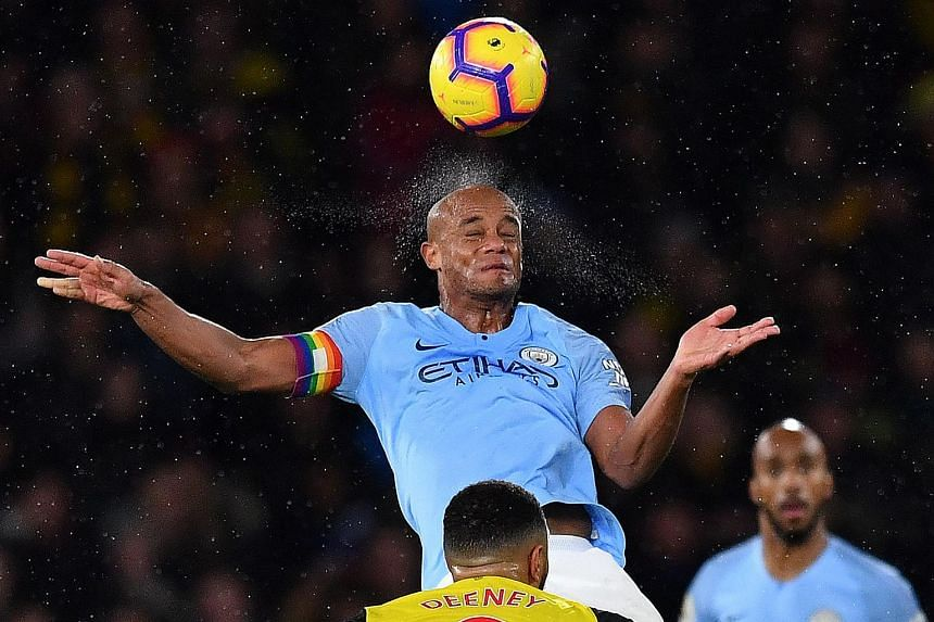 Manchester City's Belgian defender Vincent Kompany heads the ball during the EPL match between Watfordand and Manchester City at Vicarage Road Stadium in Watford, north of London, on Dec 4, 2018.