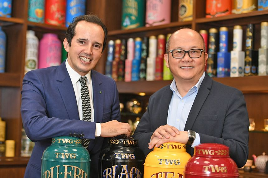 V3 founder, chairman and chief executive Ron Sim (at right) with TWG Tea chief Taha Bouqdib. V3 owns the TWG Tea brand as well as franchise rights to the GNC nutritional supplements brand in Singapore, Malaysia and Taiwan.