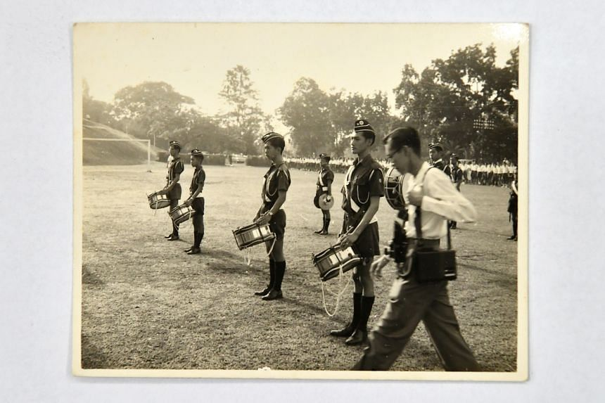 Photographs of (from top) Mr Ong in brigade uniform back in the day; his school's brigade on a trip to Batu Caves in Malaysia; and Mr Ong (third from left in picture) playing the drums during band practice. Mr Ong Eng Tong, former president of The Bo