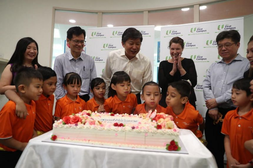 Minister in the Prime Minister's Office Ng Chee Meng joining children in celebrating the Bright Horizons Fund's tenth anniversary.