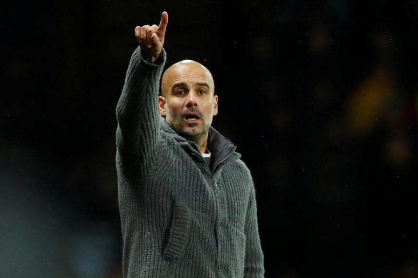 Manchester City manager Pep Guardiola gesturing on the sidelines during the EPL match against Watford on Dec 4, 2018.