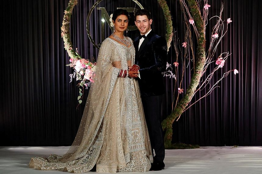 Priyanka Chopra and Nick Jonas at their wedding reception in New Delhi (above) and at their wedding ceremony on Sunday (left).