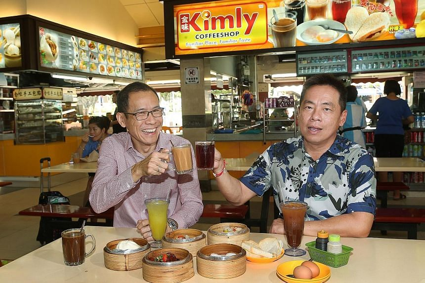 """Kimly said its executive director Chia Cher Khiang (far left) and executive chairman Lim Hee Liat had been arrested by the Commercial Affairs Department for """"having been concerned (with), or reasonably suspected of being involved in, an offence under"""