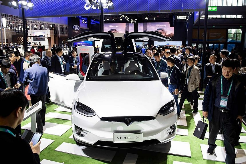 Tesla Motors' Model X car on display at the China International Import Expo in Shanghai last month. American cars are among US imports into China that have been hit by tariffs in the trade war. As part of the US-China ceasefire, both sides held off o