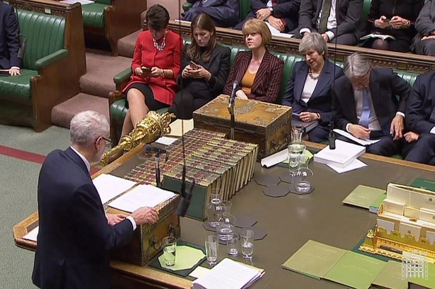 British Prime Minister Theresa May (pictured second from right) listening as Labour leader Jeremy Corbyn spoke during the debate on the Brexit deal in Parliament on Tuesday. Mrs May lost three key votes in the House of Commons, highlighting the weakn