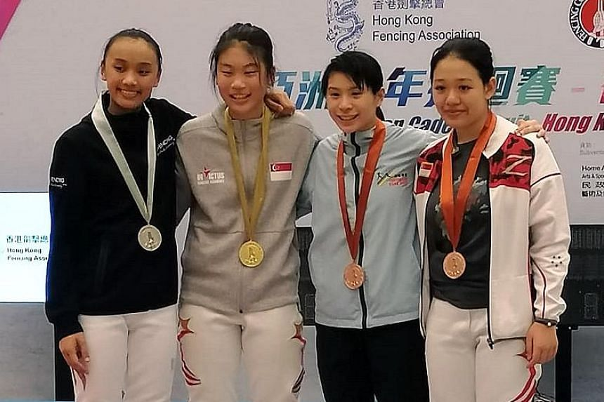 From left: Hong Kong's Daphne Chan, Singapore's Denyse Chan, Janelle Leung of Hong Kong and Singapore's Rachel Lim on the podium for the Under-17 women's foil competition at the Hong Kong Asian Cadet Circuit meet on Monday. Denyse won the title.