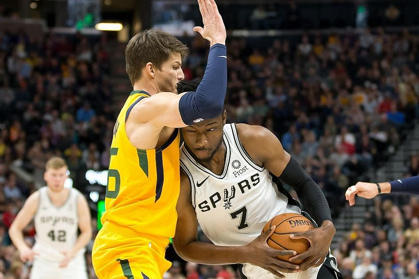 Utah Jazz guard Kyle Korver trying to block San Antonio Spurs forward Chimezie Metu from advancing during the second half of the National Basketball Association game at Vivint Smart Home Arena on Tuesday. The Jazz won 139-105.