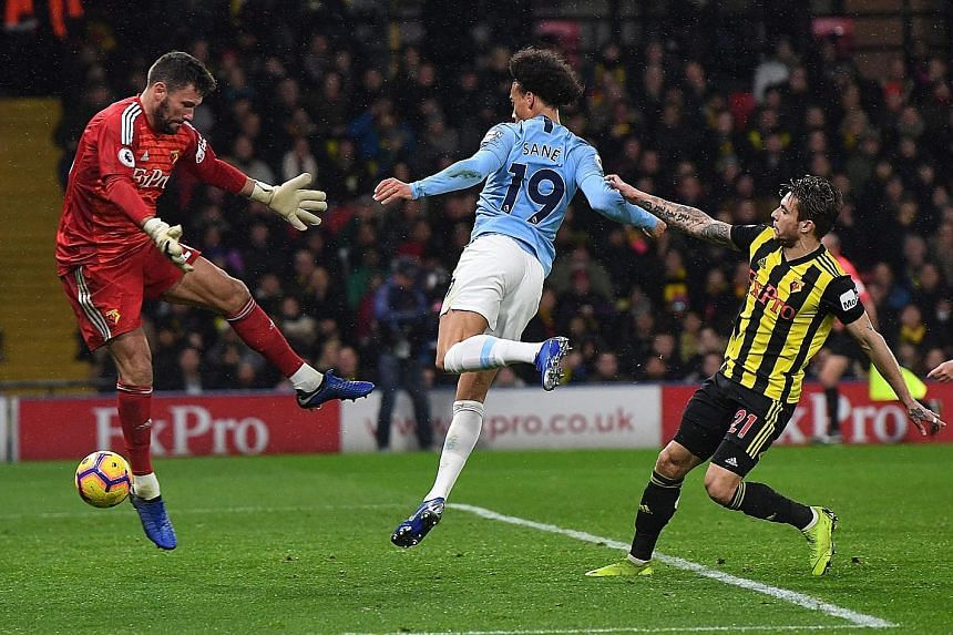 Manchester City winger Leroy Sane scoring the first goal in his side's 2-1 victory over Watford at Vicarage Road on Tuesday. It was not an easy win for Premier League leaders City, who had to hang on for the three points after Watford scored in the 8