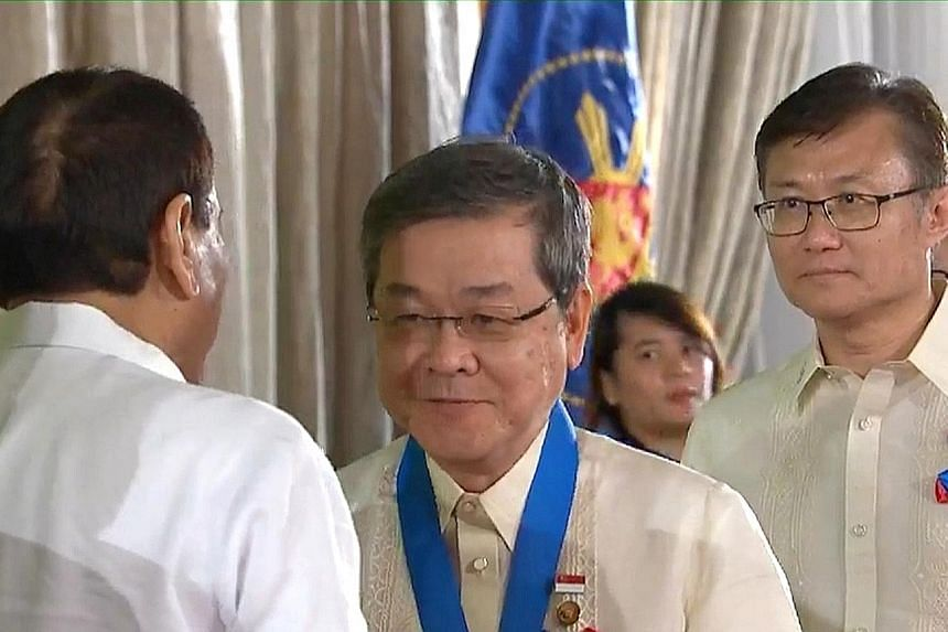 Mr Seah Seng Choon (centre) receiving the Kaanib ng Bayan (Nation's Partner) Award from Philippine President Rodrigo Duterte in Manila yesterday.