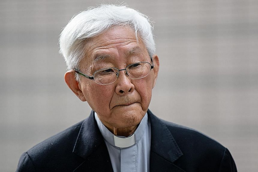 "Cardinal Joseph Zen (above) said he felt ""ashamed"" that he did not endure the pepper spray and tear gas that many demonstrators faced during the 2014 rallies. A small group of pro-democracy activists (below) protesting outside the West Kowloon Magist"