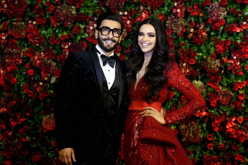 Bollywood stars Ranveer Singh (left) and Deepika Padukone during their wedding reception party in Mumbai, on Dec 1, 2018.