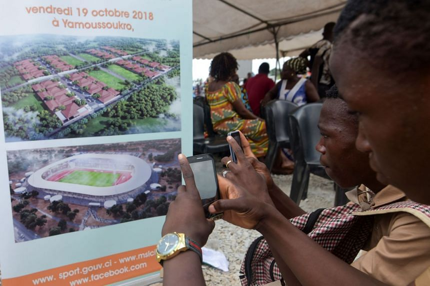 A placard representing a future stadium at the official launch of construction and infrastructure rehabilitation works for the 2021 Africa Cup of Nations in Yamoussoukro on Oct 19, 2018.