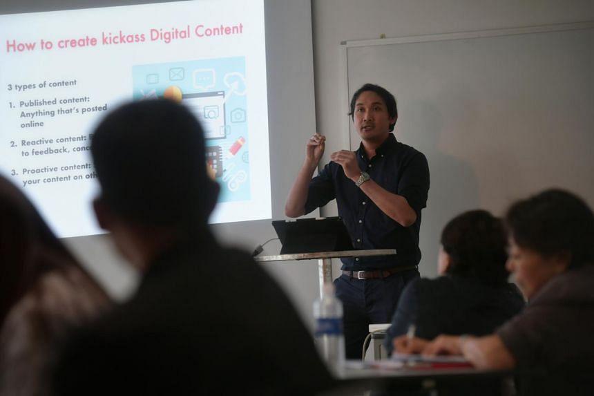 Mr Azhar Kasman, editor of citizen journalism website Stomp, conducting the ST Digital Strategy workshop at Singapore Press Holdings on Dec 6.