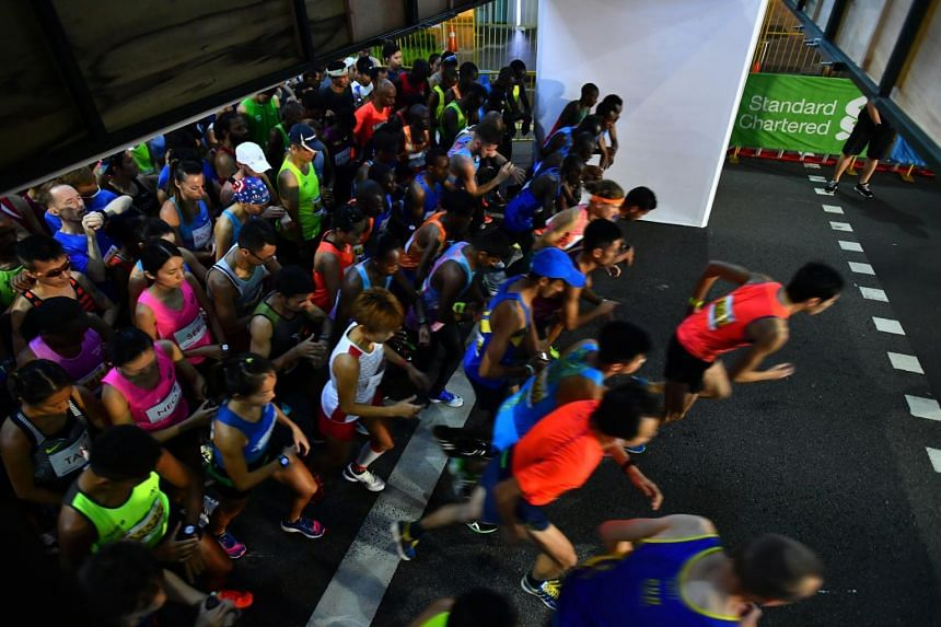 The Elite category runners being flagged off for the Standard Chartered Singapore Marathon in Orchard Road on Dec 3, 2017.
