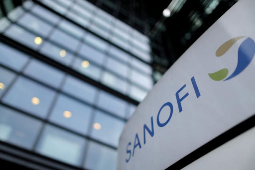 The Sanofi logo in front of the entrance of the French drug company's headquarters in Paris, Oct 30, 2014.