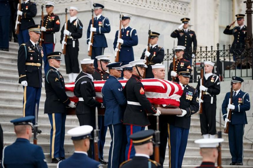 The coffin with the body of former US president George H. W. Bush departs the US Capitol during the State Funeral in Washington, DC, on Dec 5, 2018.