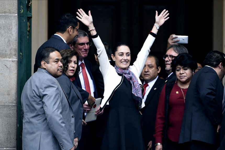 "Newly elected Mexico City's Governor Claudia Sheinbaum (centre), of the ""Juntos Haremos Historia"" (Together We Will Make History) party, waves upon her arrival to be sworn-in at the local Congress in Mexico City on Dec 5, 2018."