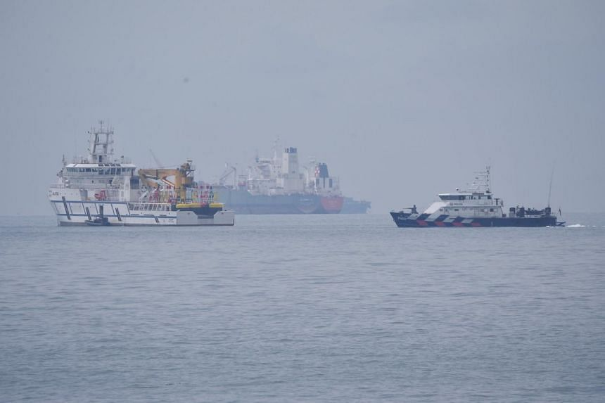 A Malaysian government vessel (left) near a Singapore Police Coast Guard vessel (right), as seen from the south of Tuas View Extension on Dec 6, 2018.