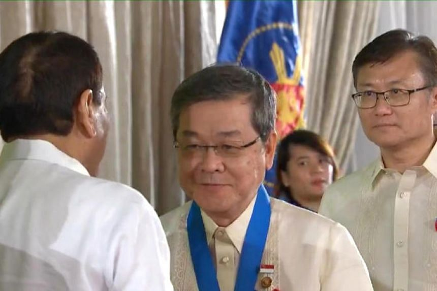 Foreign Domestic Worker Association for Social Support and Training (Fast) president Seah Seng Choon receiving the Kaanib ng Bayan (Nation's Partner) Award from Philippine President Rodrigo Duterte at an awards ceremony in Manila on Wednesday, Dec