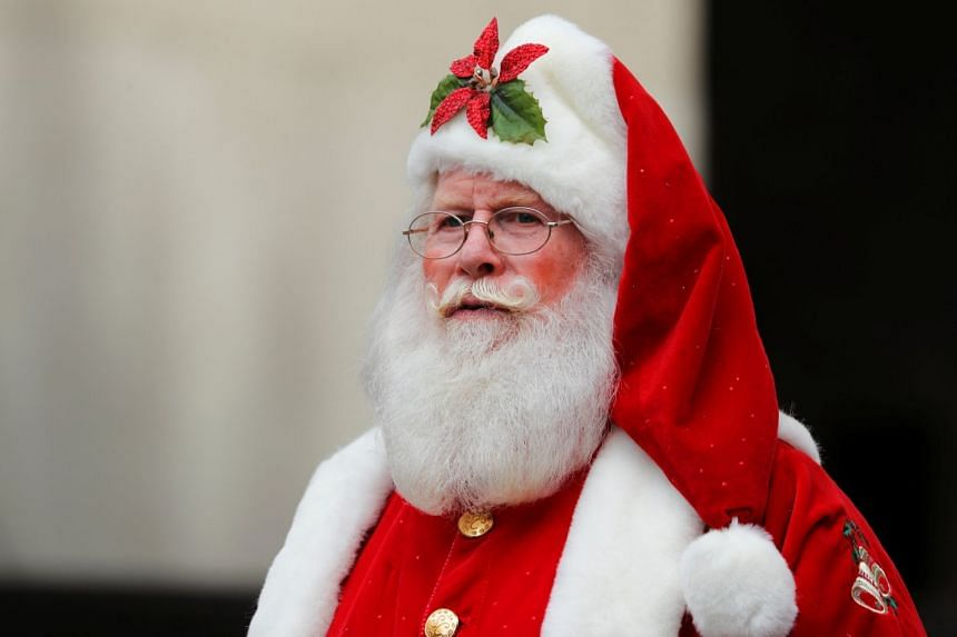 A man dressed as Santa Claus in Los Angeles on Nov 19. A woman substitute teacher at Cedar Hills School in New Jersey told her first grade students that Santa Claus is not real, leading to the school's principal apologising to parents for her actions