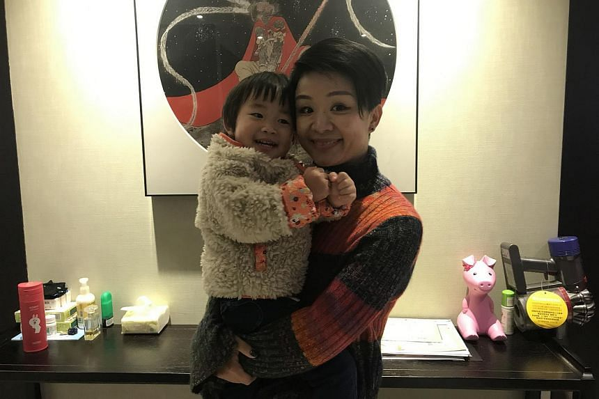 Beijing native Yuan Momo, 35, with her two-year-old daughter.
