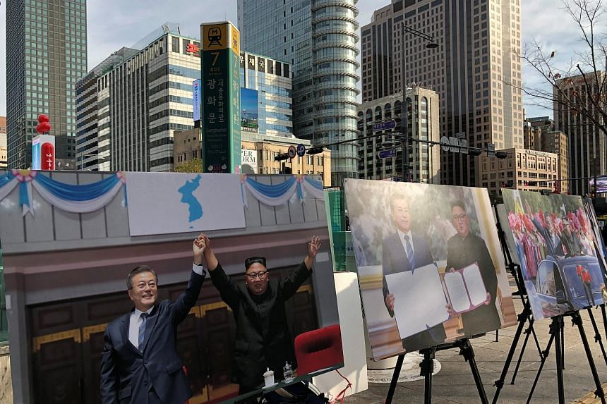 Pictures showing South Korean President Moon Jae-in and North Korean leader Kim Jong Un during their inter-Korean summit are exhibited in Seoul, on Nov 30, 2018.