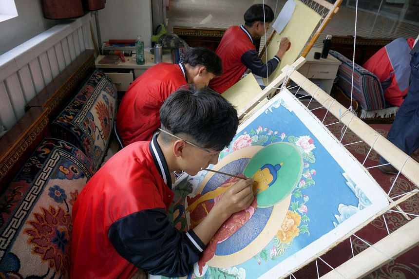 Mr Ciwang Nazha, a second-year student at the Lhasa No.2 Secondary Vocational and Technical School in Lhasa City, practises Thangka (Tibetan Buddhist) painting alongside other students.