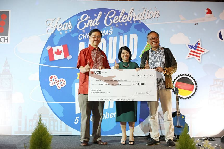 Mr Alan Lee (left) and Mr Michael Teh from Elmich presented a cheque for their donation to Ms Tan Bee Heong, general manager of The Straits Times School Pocket Money Fund, yesterday.