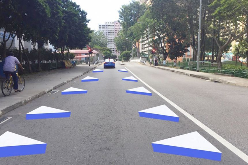 An artist's impression of the new three-dimensional road markings that will go on trial at the end of the month at the Whampoa Drive Silver Zone. The 3D images make the road look narrower and encourage drivers to slow down, said the Land Transport Au