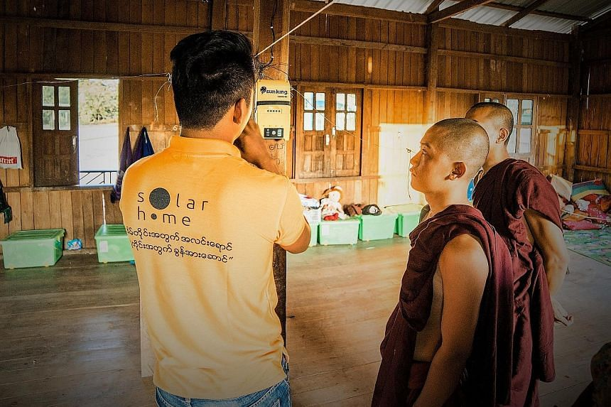 """SolarHome aims to sell its """"electricification-in-a-box"""" system to 100,000 Myanmar homes by the end of next year. Each box holds a solar panel with a battery that soaks up enough sunlight to power one household's electricity needs for about six hours"""