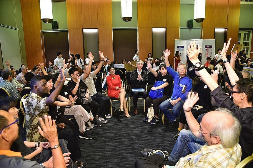 Second Minister for Finance Indranee Rajah (in red) and Reach chairman Sam Tan (centre) interacting with participants at the Pre-Budget 2019 Dialogue at the Asian Civilisations Museum yesterday. Innovation, and how the Government can give this a boos