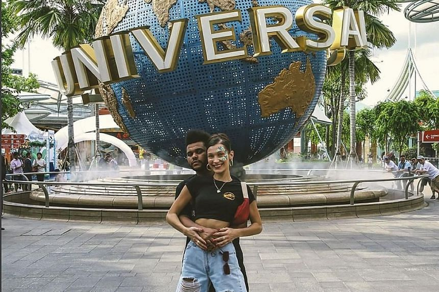 Canadian singer The Weeknd and his supermodel girlfriend Bella Hadid had a screaming good time in Sentosa a day before his concert at the Singapore Indoor Stadium on Wednesday. They visited Universal Studios, where they rode on roller coasters. He bo