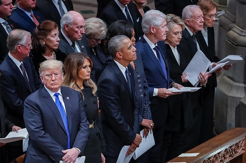 From left: US President Donald Trump, First Lady Melania Trump, Mr Barack Obama, Mrs Michelle Obama, Mr Bill Clinton, Mrs Hillary Clinton, Mr Jimmy Carter, Mrs Rosalynn Carter at the funeral service for former president George H. W. Bush on Wednesday